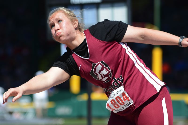SANDY POST: DAVID BALL - Sandys Hannah Gillies lets loose with a throw on her way to second place in the shot put at Saturdays state meet.