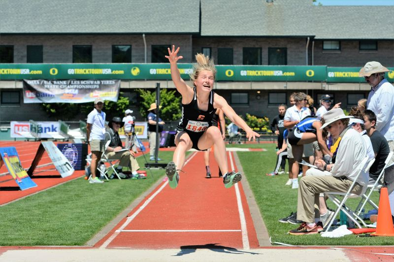 SPOTLIGHT PHOTO: JAKE MCNEAL - Indians freshman Emma Jones leapt to ninth at 16 feet, .5 inches in the girls' long jump.