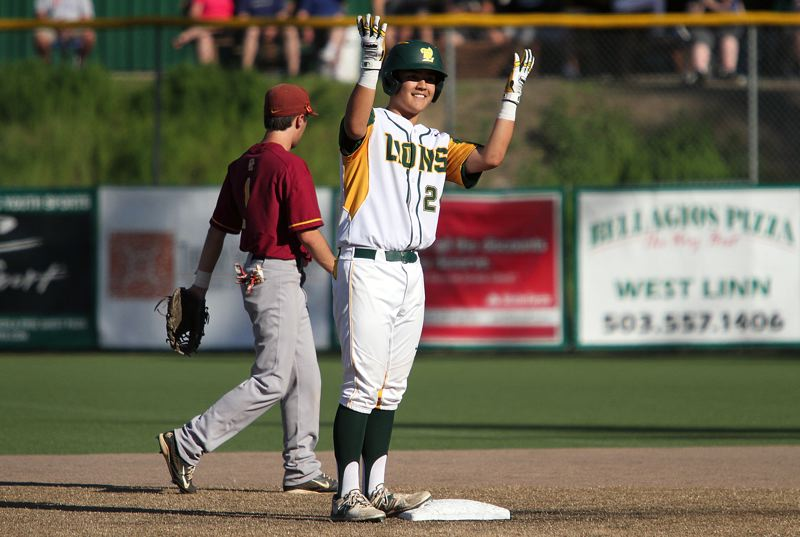 TIDINGS PHOTO: MILES VANCE - West Linn senior Micah Gibson lifts his arms after hitting a two-run double in the third inning of his team's 5-3 victory over Central Catholic in the first round of the Class 6A state playoffs at West Linn High School on Monday.