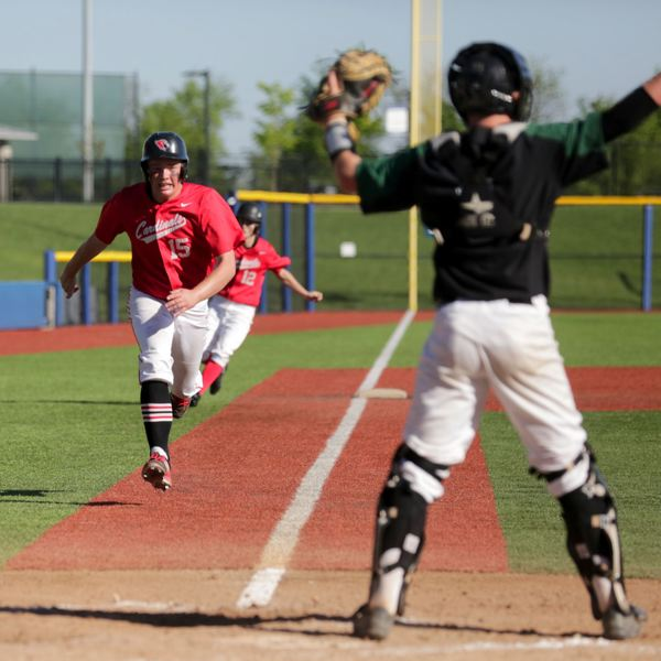 TRIBUNE PHOTO: JONATHAN HOUSE - Myles Parkel of the Lincoln Cardinals heads for home Monday against West Salem.
