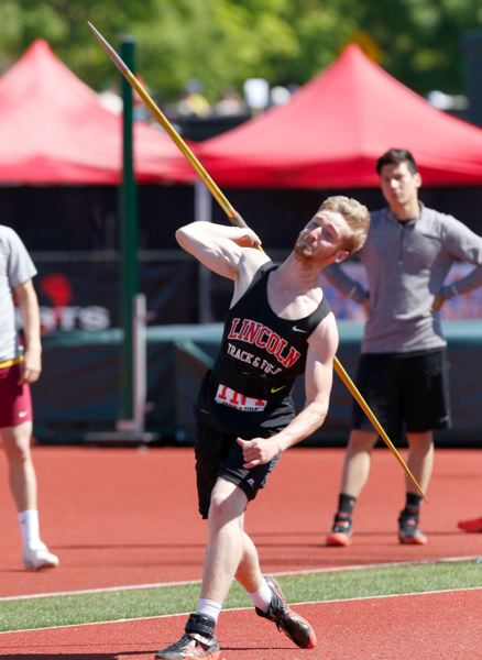 TRIBUNE PHOTO: JONATHAN HOUSE - Lincoln's Sawyer Christopher unleashes a javelin throw en route to the state title.