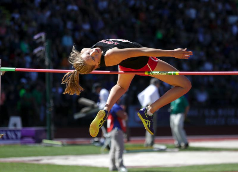 TRIBUNE PHOTO: JONATHAN HOUSE - Sydney Denham of Lincoln takes first place in the Class 6A girls high jump Saturday in Eugene.