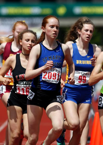 TRIBUNE PHOTO: JONATHAN HOUSE - Lara Rix of St. Mary's Academy leads Lincoln's Kyla Becker in a pack of 1,500-meter runners at the state championships in Eugene.