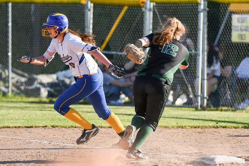 OUTLOOK PHOTO: JOSH KULLA - Barlow runner McKenzie Pierce heads for second base following a wild throw Monday in a decisive eight-run sixth inning that propelled the Bruins to a 9-0 first round 6A playoff win over Sheldon.