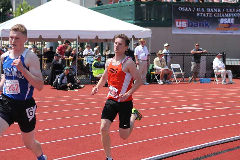 PIONEER PHOTO: CONNER WILLIAMS - Molalla senior Matthew Borowczak rounds the corner for the final lap of the 1,500 meter run at the state meet Saturday. Borowczak took eighth in the event with a time of four minutes, 15.15 seconds.
