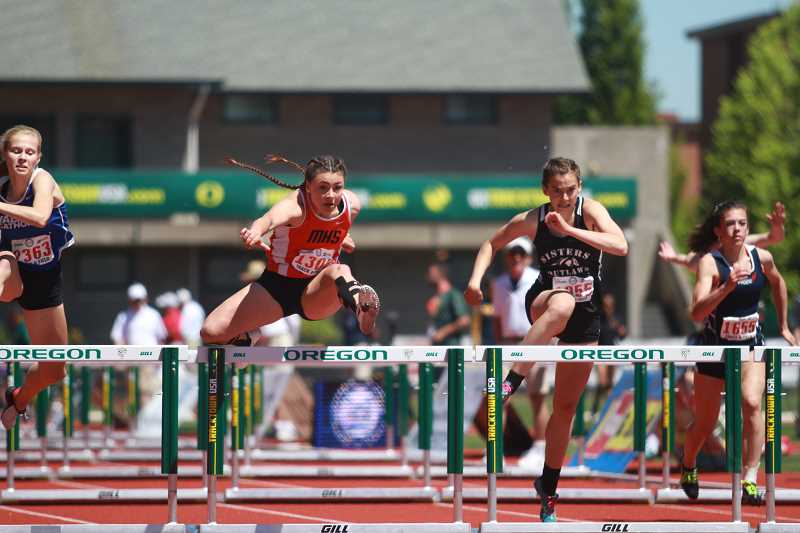 PAMPLIN MEDIA GROUP PHOTO: PHIL HAWKINS  - Molalla senior Desirae DesRosiers leaps over the final hurdle in the 100m high hurdles finals race at the state meet Saturday.