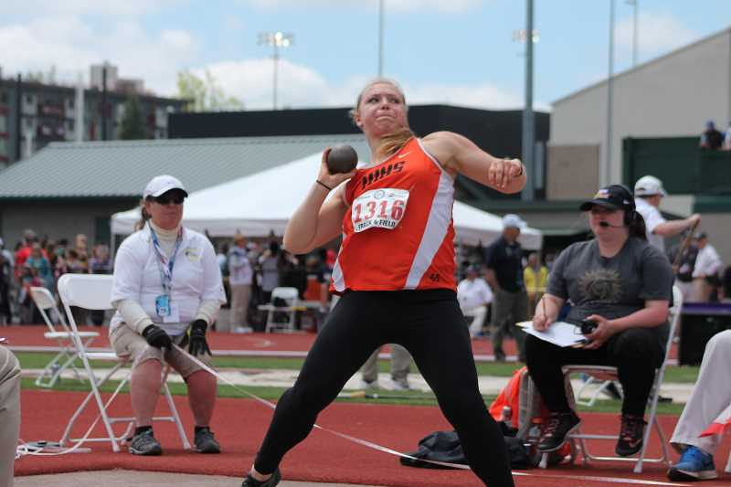 PIONEER PHOTO: CONNER WILLIAMS - Country Christian sophomore Katie Sandberg throws her shot put at the state meet Saturday.