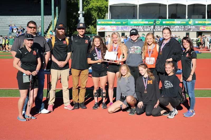 PAMPLIN MEDIA GROUP PHOTO: JIM BESEDA - Molalla track & field's coaches and female athletes pose for a photo with their second place plaque aftering tying with Phoenix for second place at the state meet Saturday, despite having only six athletes competing at the meet.