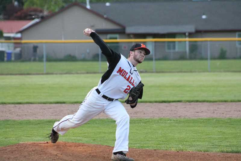PIONEER PHOTO: CONNER WILLIAMS  - Molalla senior Trevor Miles delivers a pitch during the Indians' play-in game against Junction City last Thursday.