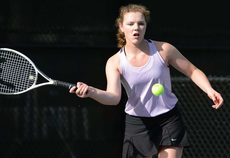 PAMPLIN MEDIA GROUP PHOTO: DAVID BALL  - Country Christian junior Mollie Lewandowski focuses on her shot during her first-round match in the statetennis tournament Saturday.