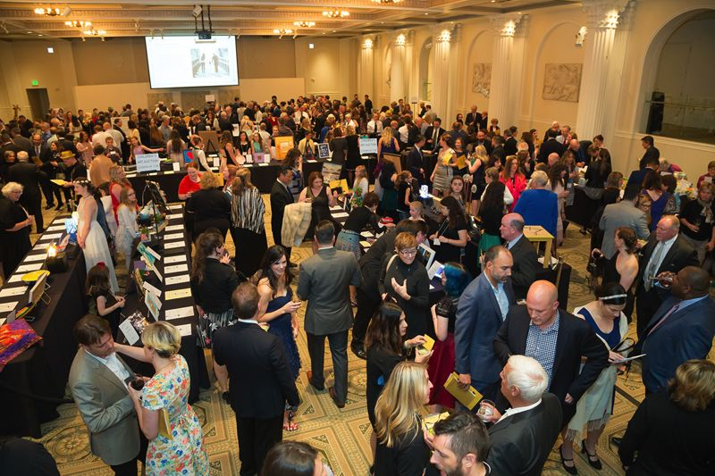 COURTESY THE DOUGY CENTER - Hundreds of people attended the 2017 Reflection Benefit, Auction, and Raffle The Dougy Center at the Portland Art Museum on May 12. They are shown here at the silent auction portion of the event.