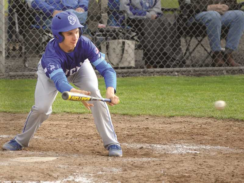 SETH GORDON - St. Paul sophomore Zach Brentano lays down a bunt in the Bucks' 5-4 loss to No. 3 Regis on May 17.