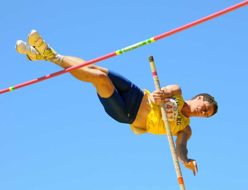 SETH GORDON - Davis Smith works his way over the bar during the pole vault competition Friday at the 6A state meet In Eugene. Davis tied a personal best by clearing 14-6 to place sixth.