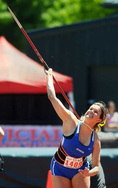 SETH GORDON - Newberg senior Natalie Peterson unleashes a throw during the finals of the javelin competition Friday at the 6A state meeet at Hayward Field in Eugene. Peterson medaled for the third time in her career, placing fifth with a throw of 133-1.