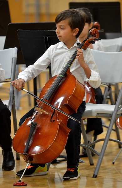 SPOKESMAN PHOTOS: VERN UYETAKE - A West Linn-Wilsonville strings student plays the cello during the district's final concert of the year Wednesday, May 17 at Wilsonville High School.