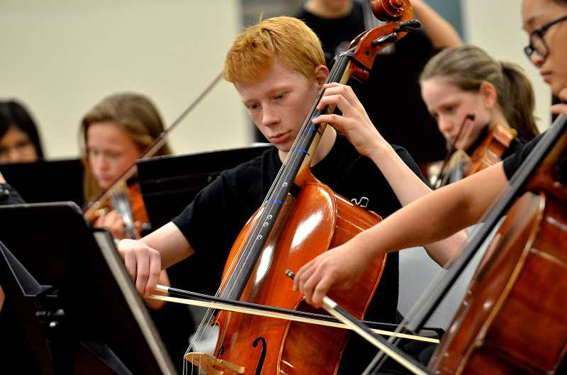 SPOKESMAN PHOTO: VERN UYETAKE - Inza R. Woods orchestra plays during their finale concert Wednesday, May 17 at Wilsonville High School.