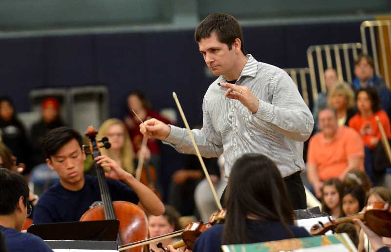 SPOKESMAN PHOTO: VERN UYETAKE - Wilsonvlle High Orchestra Teacher Chad Davies leads musicians Wednesday, May 17.