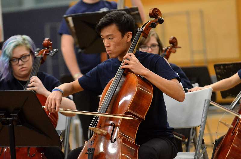 SPOKESMAN PHOTO: VERN UYETAKE - A Wilsonville High musician plays the cello as part of Wednesday's district-wide strings performance May 17.