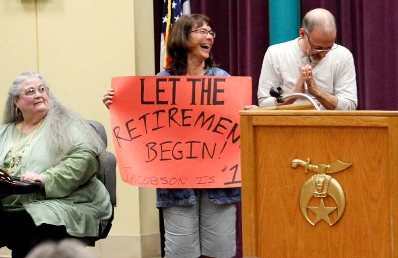 TIDINGS PHOTO: ANDREW KILSTROM - West Linn High School math teacher Keely Jacobson, middle, holds up her handmade sign Thursday, May 18 at Al Kader Shrine Center in Wilsonville.