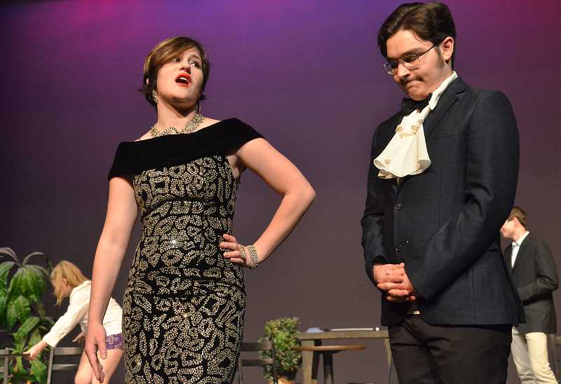 REVIEW PHOTO: VERN UYETAKE - Lake Oswego High school students (from left) Lindsey Stern and Chase Vernon reherase a scene Tuesday in preparation for 'The Big Hotel: A Magical Murder Mystery!' There are three show times on Friday and Saturday only.