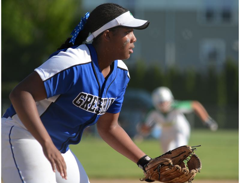 OUTLOOK PHOTO: DAVID BALL - Gresham's Dosjanee McCloyn keeps her eyes on the play, while a Cleveland runner makes her move off second base during the Gophers' 8-0 playoff win Monday.