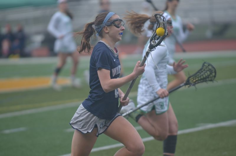 SPOKESMAN PHOTO: COREY BUCHANAN - Wilsonville sophomore Marri McCallum races up the field during the Wildcats quarterfinals victory over West Linn Wednesday, May 17 at West Linn High School.