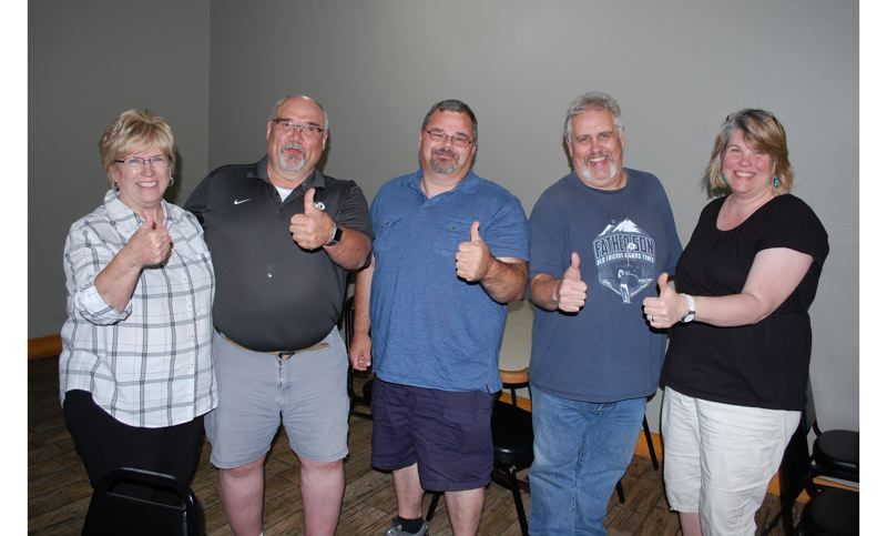 PHOTO BY: RAYMOND RENDLEMAN - Celebrating the results of the recall election on May 23 at Lee's Teriyaki in Gladstone are, from left, Sharon Alexander, Neal Reisner, Bill Osburn, Greg Alexander and Katie Lewis.