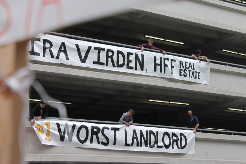 TRIBUNE PHOTO: LYNDSEY HEWITT - Activists made a scene downtown to shame a landlord.