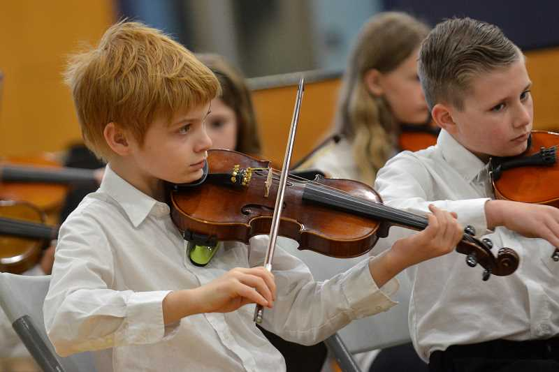 VERN UYETAKE - Elementary-aged students played the violin, viola and cello during their finale concert Wednesday, May 17 at Wilsonville High.