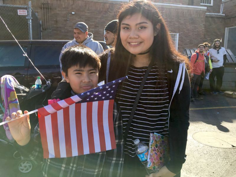 TRIBUNE PHOTO: LYNDSEY HEWITT - Irina Bautista, 18, posed with her little brother, Jorge at the march in February. They said they would likely have to move from the Normandy complex.