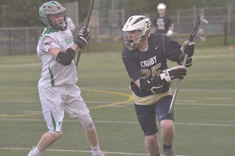 HERALD PHOTO: COREY BUCHANAN -  Canby lacrosse player Tayvn Jorgensen scored one goal against Tigard.