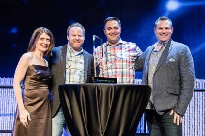 SUBMITTED PHOTO - Microsoft Director of Partner Sales, Kelly Thomas Nojaim, left, awards Lake Oswego-based digital marketing agency, Logical Position, with Growth Channel Partner of the Year, at the inaugural Global Bing Partner Awards.
