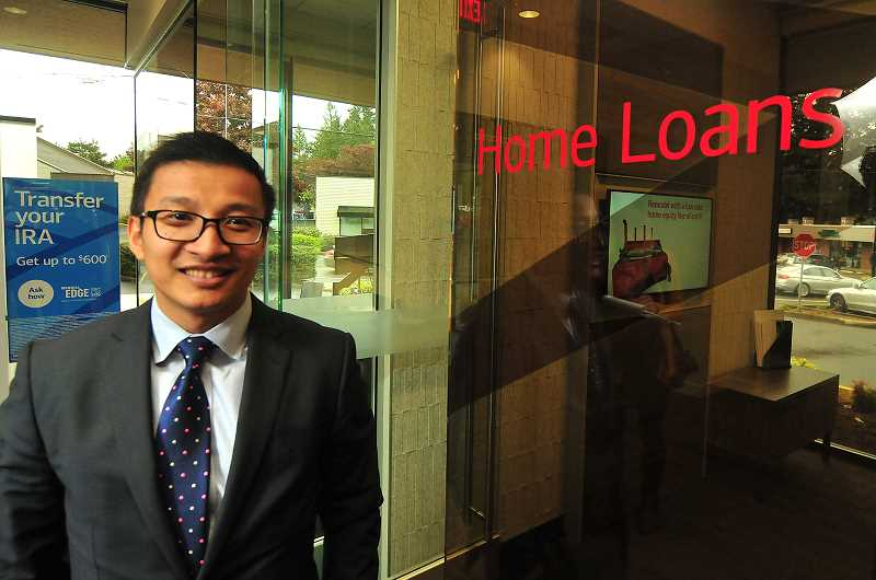 STAFF PHOTO: VERN UYETAKE - At Bank of Americas newly renovated Financial Center in Lake Grove, home loan, small business loan and investment specialists are on hand to help clients meet their financial goals, says Nathan Nguyen, regional sales executive for Washington and Oregon.