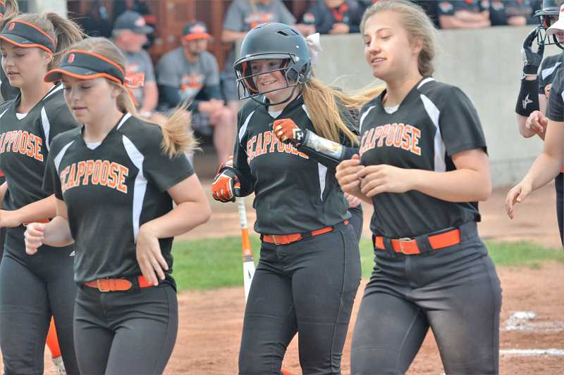 SPOTLIGHT PHOTO: JAKE MCNEAL - Sophomore Sara Mills, center, and the Indians celebrate her third-inning two-run shot to center that tied the game at 2-2.