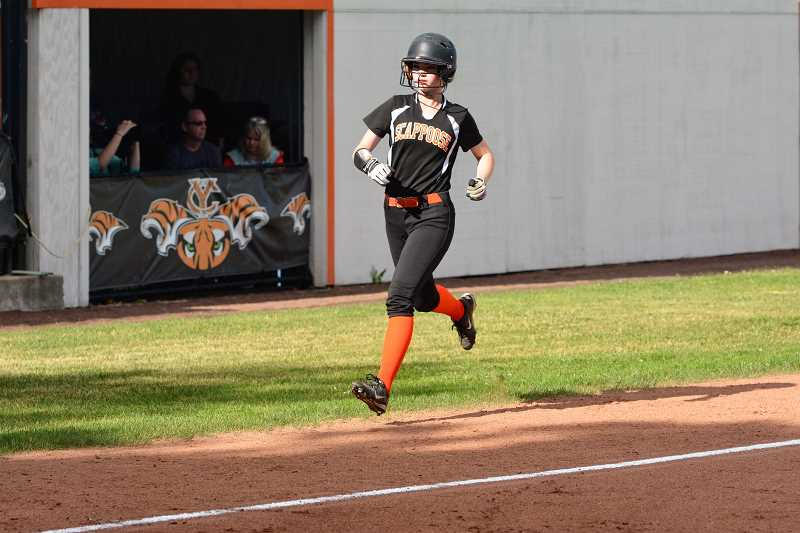 SPOTLIGHT PHOTO: JAKE MCNEAL - Indians sophomore Taylor Johnson makes the first of her two trips across the plate on Sara Mills' third-inning home run.