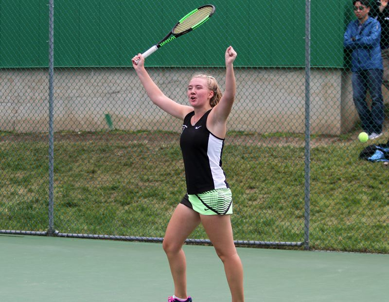 PAMPLIN MEDIA GROUP: MILES VANCE - Tigard High School freshman Lizzy Stevens celebrates after winning the Class 6A girls singles championship.