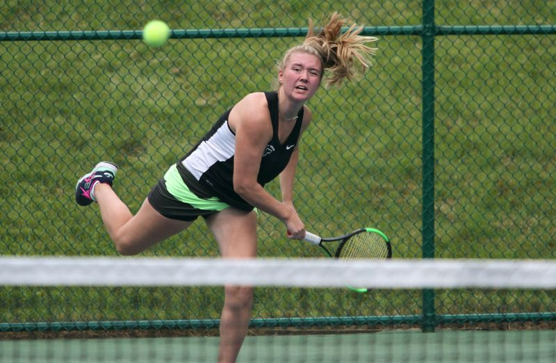 PAMPLIN MEDIA GROUP: MILES VANCE - Tigard freshman Lizzy Stevens hits a hard shot durng the Class 6A girls tennis title match.