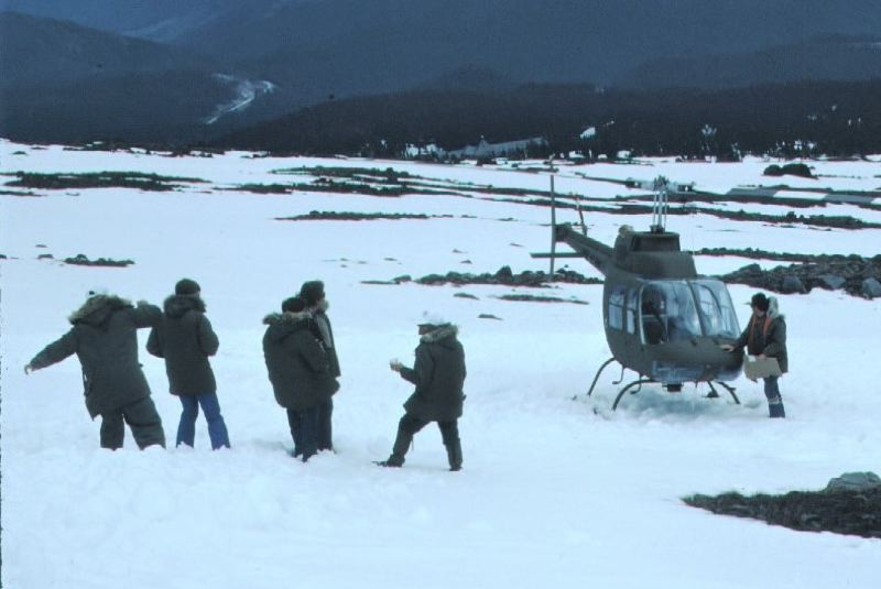 CONTRIBUTED PHOTO: BRUCE HAYNES - World War III movie director Boris Sagal, second from right, gives his final instructions prior to the colossal film shooting mistake that will send him into the rage that will lead to his fatal accident. The person beside the helicopter is the pilot. Note Timberline Lodge downslope at the top of the mountains timberline. Local mountain resident Bruce Haynes, who was an extra in this movie, took this photo.