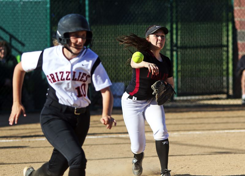 DAN BROOD - Tualatin junior third baseman Amanda Reser (right) throws out McMinnville freshman Megan Bomberger on a bunt during Wednesday's state playoff game.