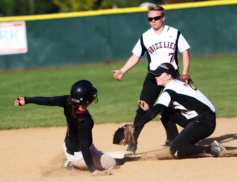 DAN BROOD - Tualatin senior Amanda Reser (left) is tagged out by McMinnville junir second baseman Hanna Young during Wednesday's state playoff game.