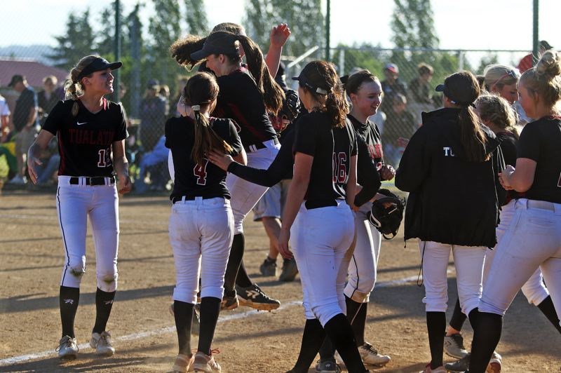 DAN BROOD - The Timberwolves celebrate after getting the final out in their 7-1 state playoff win over McMinnville on Wednesday.