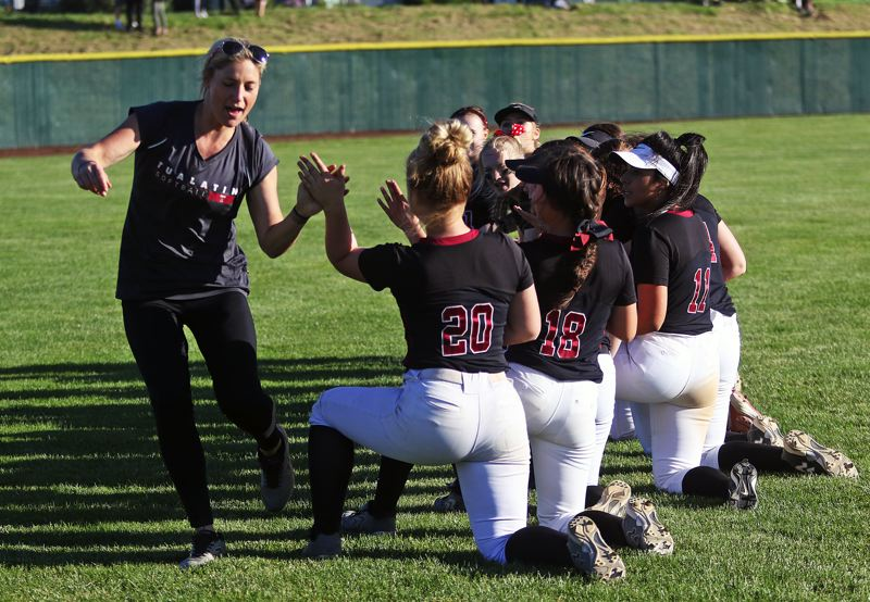 DAN BROOD - Tualatin coach Jenna Wilson (left) celebrates with her team following the 7-1 state playoff win over McMinnville.