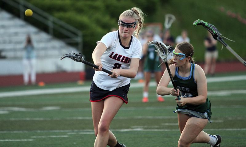 REVIEW PHOTO: MILES VANCE - Lake Oswego freshman Katie Freeman fires off a shot during her team's 13-3 win over Oregon Episcopal School in the Oregon Girls Lacrosse Association state championship game on Wednesday night at Wilsonville High School.