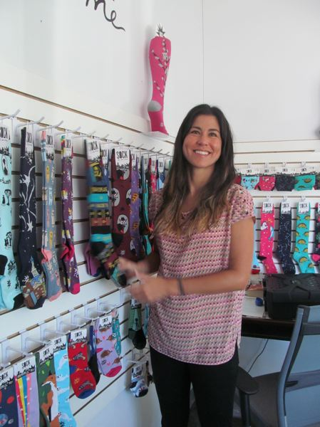 PHOTO BY ELLEN SPITALERI - Carrie Atkinson, founder of Sock It to Me, restocks socks at the company's warehouse in Milwaukie.