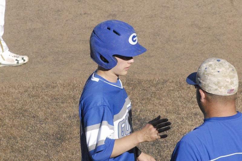 GRESHAM OUTLOOK: MATT RAWLINGS - Brett Falkner (left) chats with his coach Ryan Miller (right) at third base in Gresham 8-1 loss to West Linn