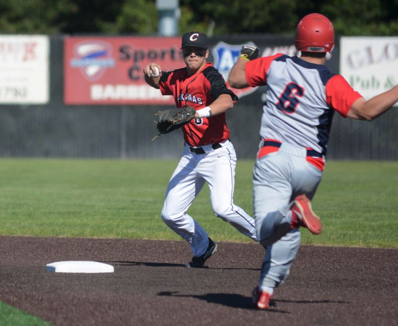 PAMPLIN MEDIA: DAVID BALL - Clackamas shortstop Bubba Jaha turns to complete a double play that ended the first inning.