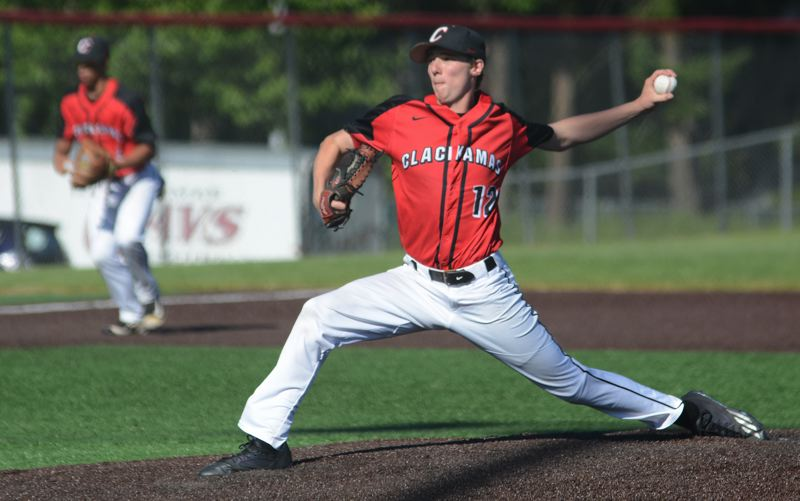 PAMPLIN MEDIA: DAVID BALL - Clackamas pitcher K.C. Reilly went the distance, striking out six and retiring the side in order twice.