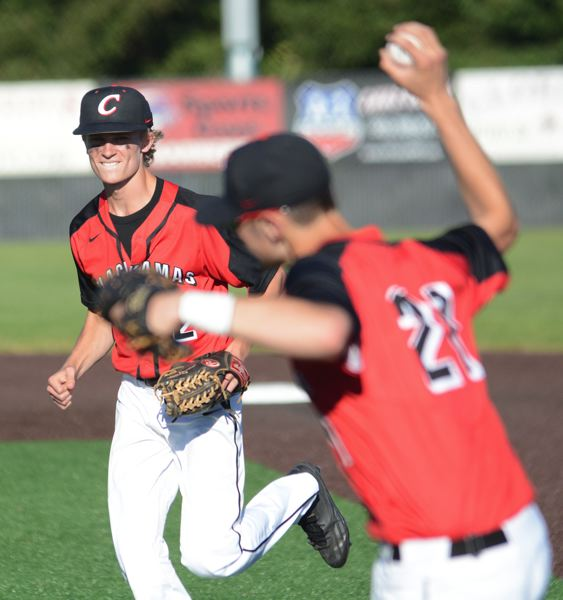 PAMPLIN MEDIA: DAVID BALL - Clackamas infielders Ryan McDonald, left, and Greg Mehlhaff celebrate and collecting the final out of the game.