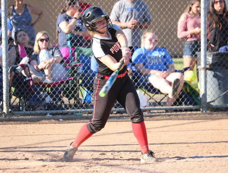 REVIEW/NEWS PHOTO: JIM BESEDA - Ashley Spencer's RBI-single scored Morgan Hornback with the go-ahead run, capping a four-run rally in the fifth inning that helped lift Oregon City to a 7-4 home win Friday over McNary.