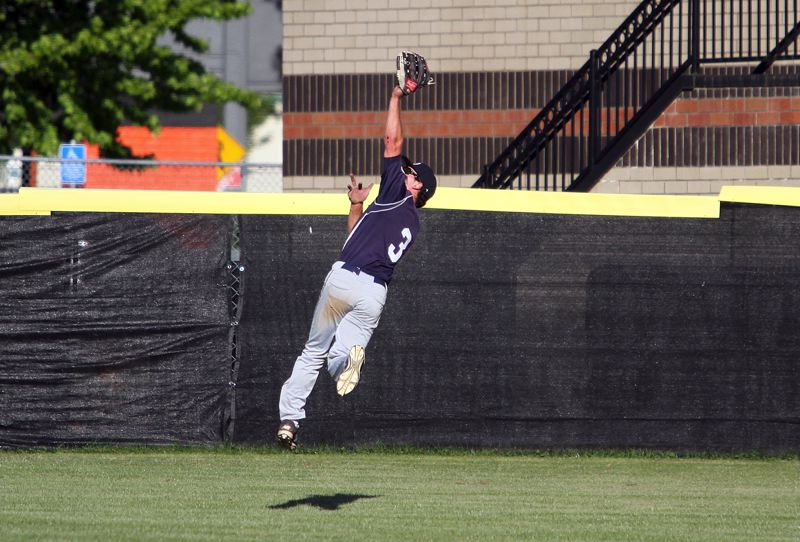 PMG PHOTO: MILES VANCE - Lake Oswego center fielder Matt Sebolsky makes a running, leaping catch during his team's 9-6 loss at Beaverton in the Class 6A state quarterfinals on Friday.